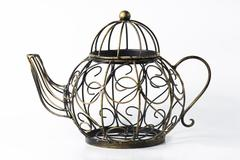 Metal wireframe teapot on white Stock Photos
