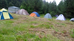 Tent camp meadow high in the mountains. Stock Footage