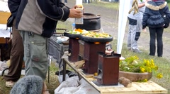 Cooking outdoors with ecological stoves. Stock Footage