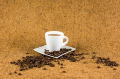 coffe cup on brown background texture - stock photo