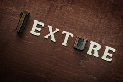 The word texture written on wooden background Stock Photos