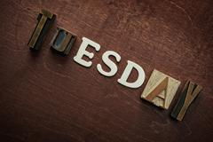 the word tuesday written on wooden background - stock photo
