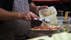 Street vendor preparing crepe in Barcelona market Stock Footage