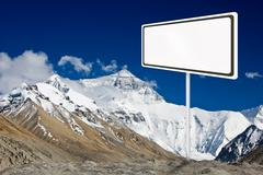 Blank billboard surround by mountain range. Stock Illustration