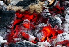 Glowing embers in the ash closeup Stock Photos
