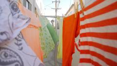 POV walk through colorful clothes drying on clothesline. Stock Footage