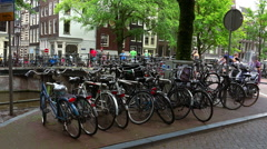 Bikes attached to a bridge in Amsterdam - stock footage