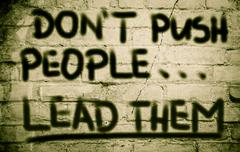 Don't push people lead them concept Stock Illustration