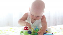 Kid playing with toys at home closeup Stock Footage