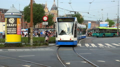 Public transport in Amsterdam tram and bus - stock footage