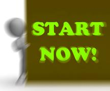 Start now placard means immediate action or beginning Stock Illustration