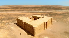 Aerial Drone Footage of a Small Castle in the Eastern Desert of Jordan Stock Footage
