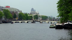 Famous Magere Brug Bridge in Amsterdam over Amstel river Stock Footage