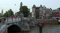 Wonderful bridge over Amstel River in Amsterdam Stock Footage