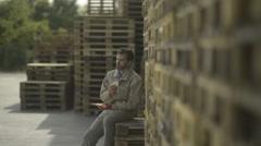 Manual worker having a lunch break; Full HD Photo JPEG Stock Footage