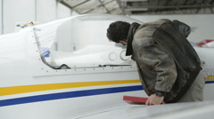 Pilot standing next to airplane; Full HD photo JPEG Stock Footage