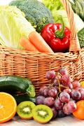 Wicker basket with groceries. balanced diet Stock Photos