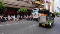Tuktuk moving along a street in Bangkok, Thailand Stock Footage
