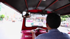 Tuktuk moving along a street in Bangkok, Thailand Stock Footage