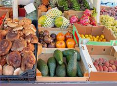 Market stall with fruits and vegetables in crates Stock Photos