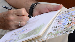 Sketcher drawing in a book Stock Footage