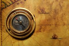 Vintage compass on the old map Stock Photos