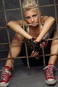 punk girl behind bars - stock photo