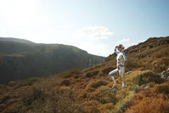 Cyber woman in the mountains Stock Photos