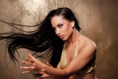 beautiful woman in bikini performing ritual dance - stock photo
