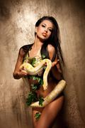 Attractive brunette woman with albino python Stock Photos