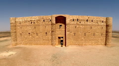 Aerial, drone footage of a small castle in the eastern desert of Jordan. Stock Footage