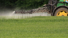 Spraying crops field with tractor and sprayer, farming, harvest Stock Footage