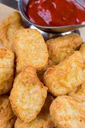 fast food fresh hot chicken nuggets with ketchup - stock photo