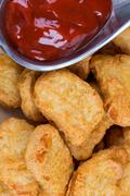 Fast food fresh hot chicken nuggets with ketchup Stock Photos