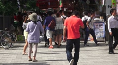 Shopkeepers Hand Out Flyers On Sidewalk In Akihabara 4K Stock Footage