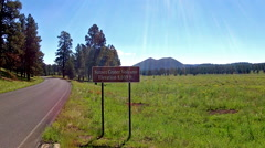 Sunset Crater Volcano Sign And Wide Vista With Road Stock Footage