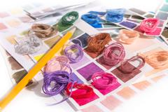 needlework. embroidery. match colors of thread. - stock photo