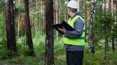 Forest Officer inspect forest Stock Footage