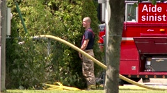 Fireman urinating at scene of house fire Stock Footage