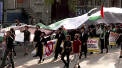 Hasidic Jewish people marching and protesting Stock Footage