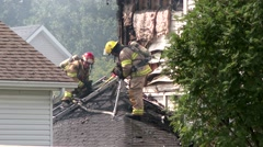 Fireman punches hole in roof with piercing nozzle - stock footage