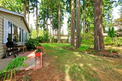 countryside house backyard with trees - stock photo