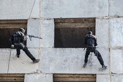 tactical rappeling - stock photo