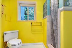 bright yellow bathroom interior - stock photo