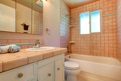 Warm bathroom interior in light peach Stock Photos
