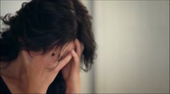 Sad frustrated woman emotion face in hands crying Stock Footage