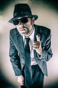 Man in Suit Finger Gun Point - stock photo