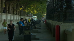 Runners on the Embankment, London. 4K version Stock Footage