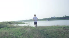 Jogger running at the river Stock Footage