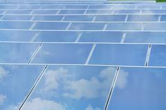 reflexion of the sky on solar cells - stock photo